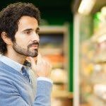 Attractive man shopping in a supermarket